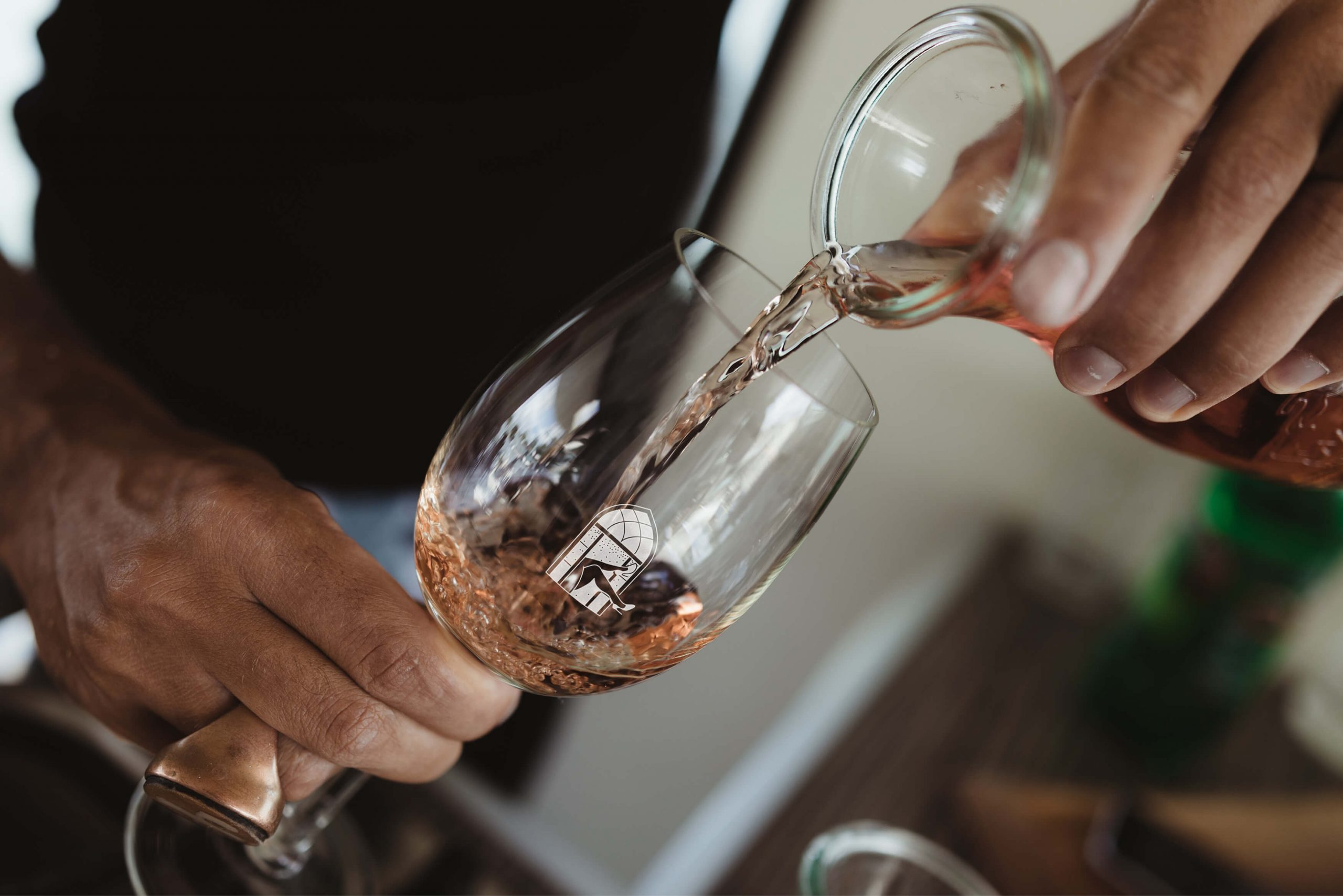 Ovolo Za Za Ta Hospitality Visual Identity - Brand wine glass being poured