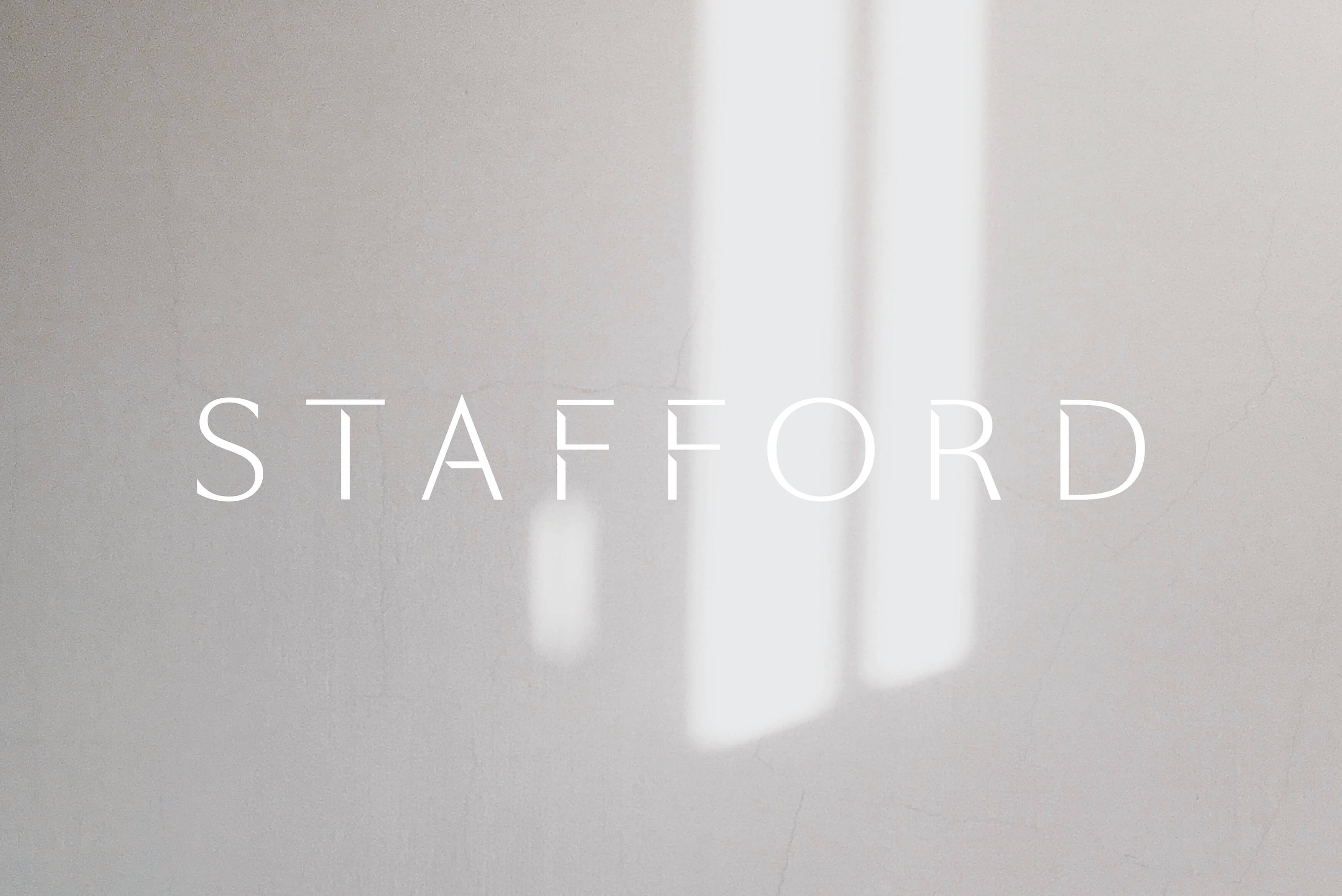 Stafford Architecture - Brand logotype on photograph on sunlight casting shadows on wall